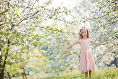 Little girl in blooming cherry tree garden outdoors on Easter eve Royalty Free Stock Photo