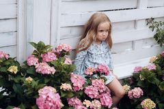 Little girl at blooming flower. Childrens day. Small baby girl. New life concept. Spring holiday. Summer. Mothers or. Womens day. Spring flowers. Childhood. Hot royalty free stock photo