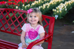 Little girl at blooming tulip fields Royalty Free Stock Image