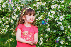 Little girl in blossoming Apple orchard Royalty Free Stock Image