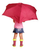 Little girl in blouse, skirt, rubber boots with umbrella standing. Royalty Free Stock Images