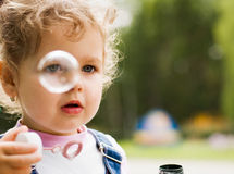 Little girl blow bubbles Royalty Free Stock Image