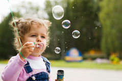 Little girl blow bubbles Royalty Free Stock Images