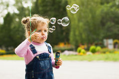 Little girl blow bubbles Stock Photo