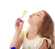 Little girl blow bubbles. Stock Image