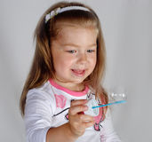 Little girl blowing Royalty Free Stock Photo