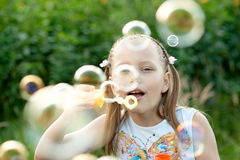 Little Girl blowing bubbles Royalty Free Stock Photo