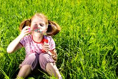Little girl blowing bubbles Royalty Free Stock Image