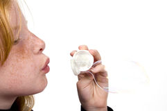 Little girl is blowing bubbles Stock Image