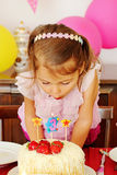 Little girl blowing the candles Stock Photo