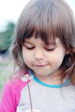 Little Girl Blowing on Dandelion Stock Photos