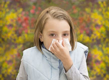 Little girl blowing her nose Stock Image