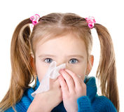 Little girl blowing her nose closeup isolated. On white Royalty Free Stock Photo