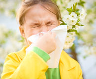 Little girl is blowing her nose Stock Photography