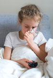 Little girl blowing her nose. Stock Photography
