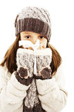 Little girl blowing her nose. Winter style. Stock Photo
