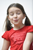 Little Girl Blowing a Kiss Stock Images