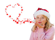 Little girl blowing love heart kisses. Isolated on white background stock image