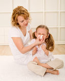 Little girl blowing nose Stock Photos