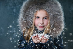 Little girl blowing snow Stock Images