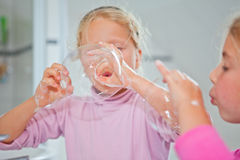 Little girl blowing soap bubble Stock Image