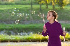 Little girl blowing soap bubbles Royalty Free Stock Photography