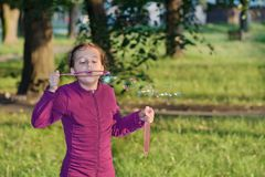 Little girl blowing soap bubbles Royalty Free Stock Photos