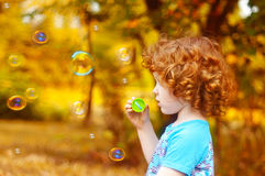 A  little girl blowing soap bubbles, closeup portrait beautiful Royalty Free Stock Image