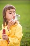 Little girl blowing soap bubbles Royalty Free Stock Photo