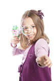 little girl blowing soap bubbles Stock Image