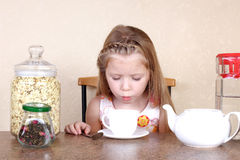 Little girl blowing to cup of hot drink Royalty Free Stock Images