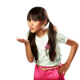 Little girl blows with an empty hand Stock Photo