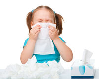 Little girl blows her nose. Isolated over white Royalty Free Stock Image