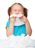 Little girl blows her nose Royalty Free Stock Photography