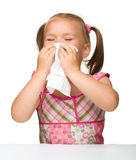 Little girl blows her nose Stock Photo