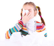 Little girl blows her nose Stock Images