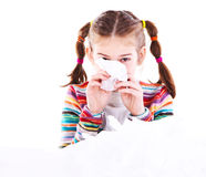 Little girl blows her nose Royalty Free Stock Photos