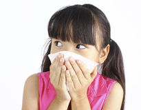 Little girl blows her nose Royalty Free Stock Photo
