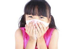Little girl blows her nose Royalty Free Stock Images