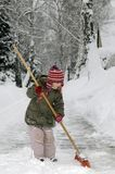 Little girl blows snow Stock Image