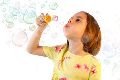 Little girl blows soap bubble Stock Photography