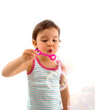 Little girl blows soap bubbles over white Royalty Free Stock Photo