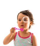 Little girl blows soap bubbles over white Stock Photo