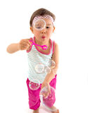 Little girl blows soap bubbles over white Stock Photography