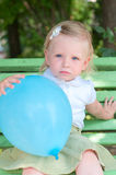 Little girl with blue air balloon Royalty Free Stock Photography