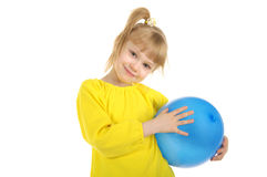 Little girl with blue ball Stock Image
