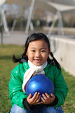 Little girl and blue ball stock photo