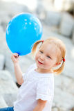 Little girl with blue balloon Royalty Free Stock Photos