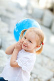 Little girl with blue balloon Royalty Free Stock Images