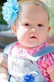 Little girl with a blue bow Stock Photo